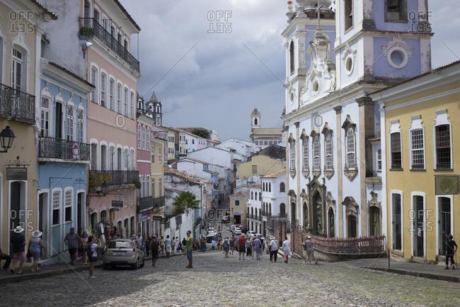Salvador da Bahia, Brazil - April 20, 2015: Tourists walking on a cobblestone street in Salvador da Bahia, Brazil