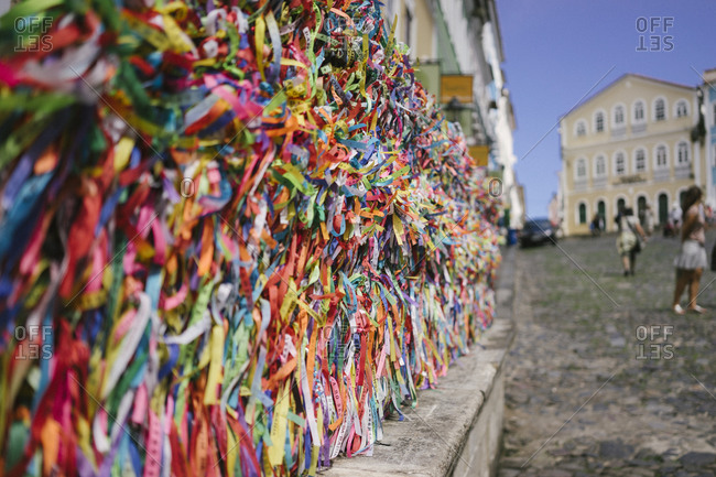 Colorful ribbons with prayers tied to a fence in Salvador da Bahia, Brazil