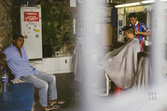 Salvador da Bahia, Brazil - April 20, 2015: Men in a barber shop in Salvador da Bahia, Brazil