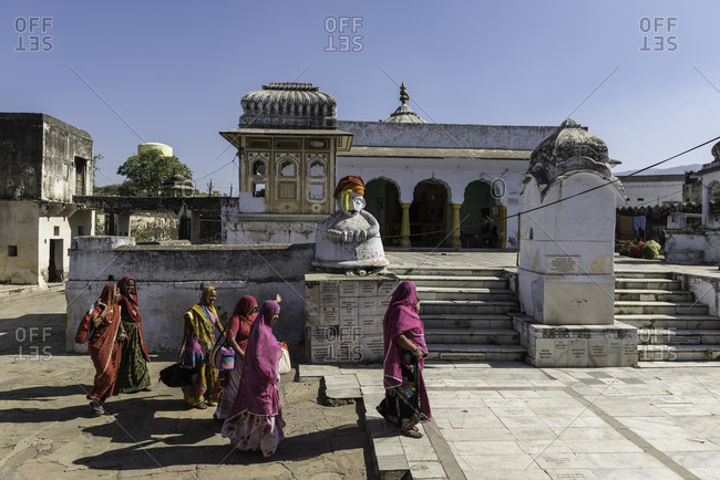Rajasthan, India - November 19, 2015: Group of Indian women walking in front of a temple