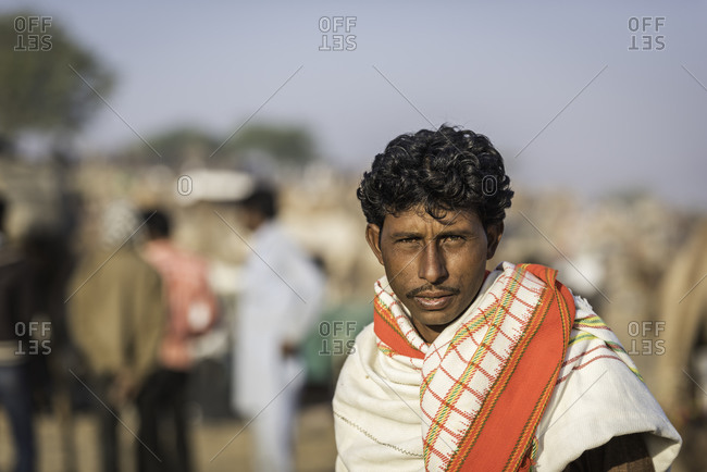 Rajasthan, India - November 20, 2015: Young Indian man in a red patterned scarf