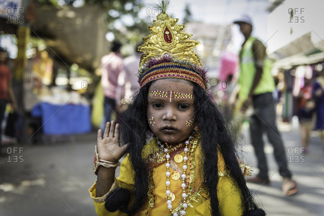Rajasthan, India - November 19, 2015: Little girl dressed up in traditional Indian clothing and face paint