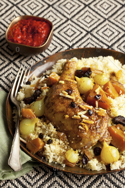 Plate of chicken and couscous with raisins and almonds
