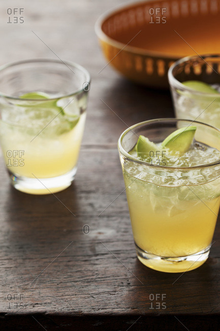 Glasses of lime cocktails on wood table