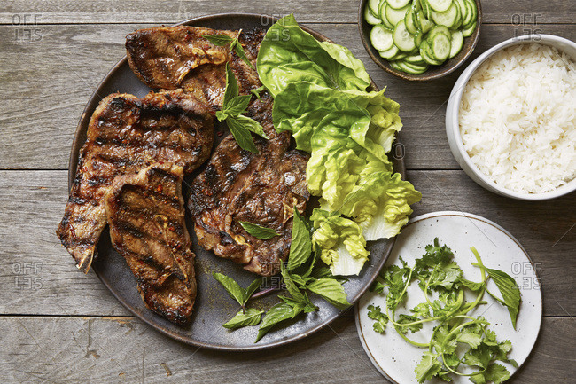 Grilled Sichuan cumin lamb chops with quick pickled cucumbers and rice