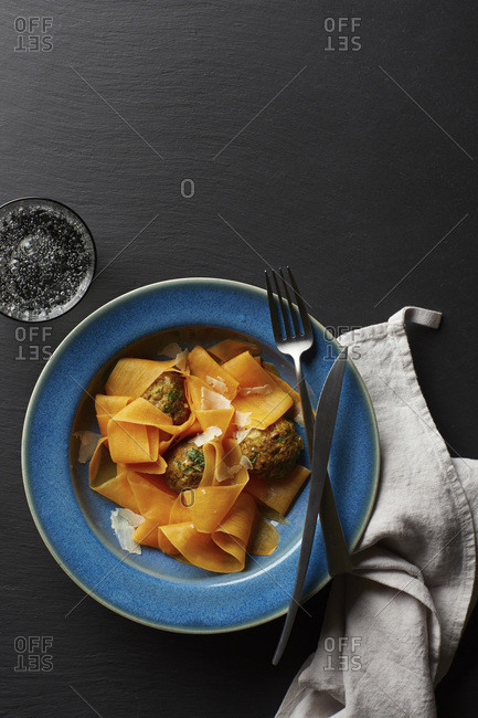 Carrot ribbons in bowl with meatballs
