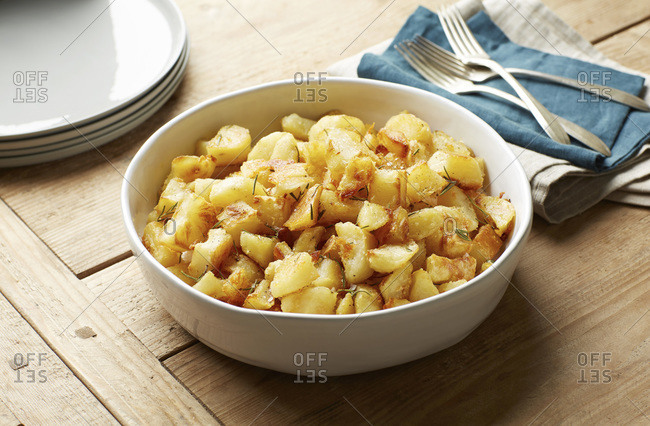 Bowl of roasted potatoes with rosemary
