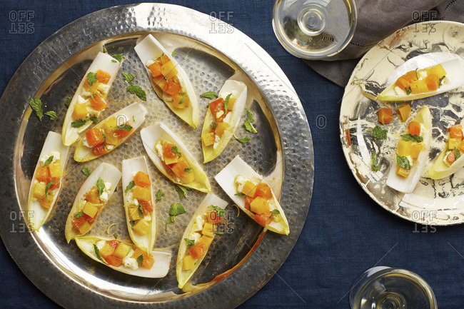 Endive leaf appetizers with fresh mint and diced tomatoes