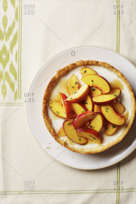 Overhead view of tart with fresh peaches