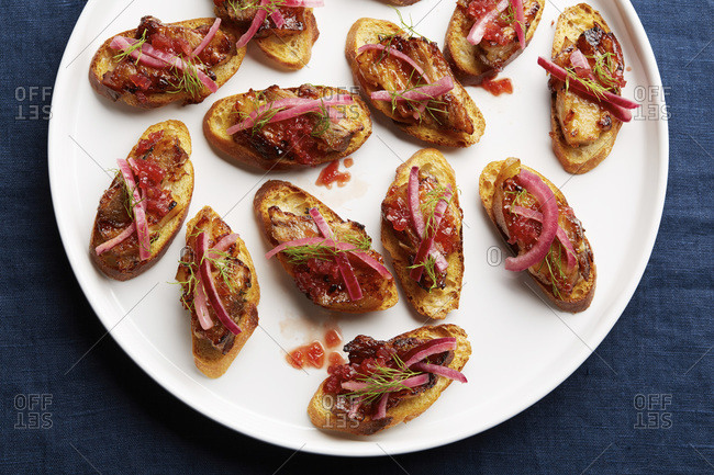 Pork belly toasts with pickled onion and fresh dill