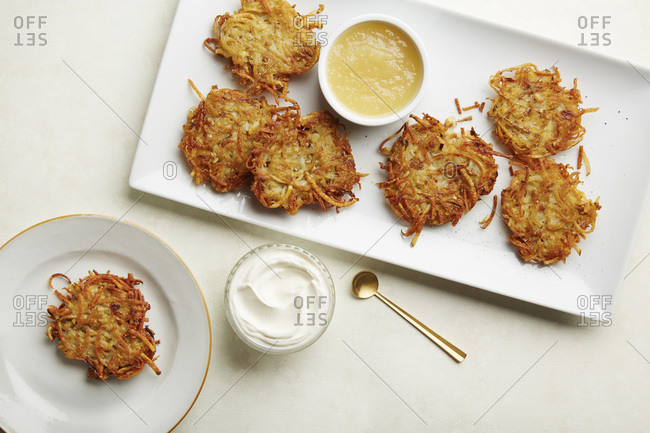 Platter of latkes with applesauce and sour cream