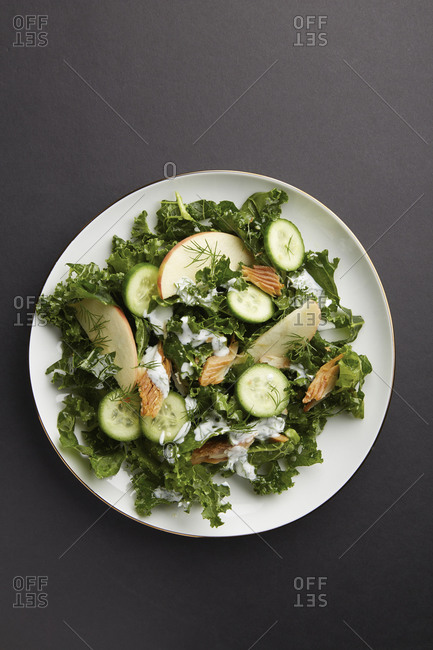 Overhead of kale salad with tuna and apple slices