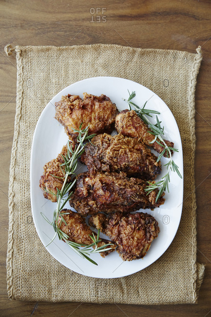 Platter of fried chicken with rosemary and cornbread