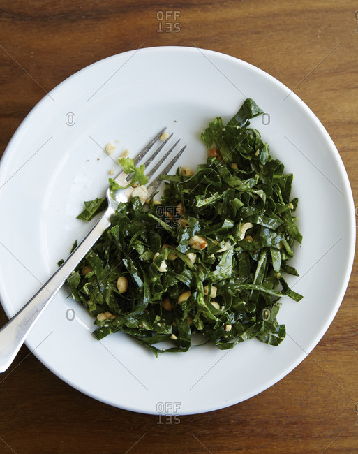 Wilted kale salad with chopped nuts