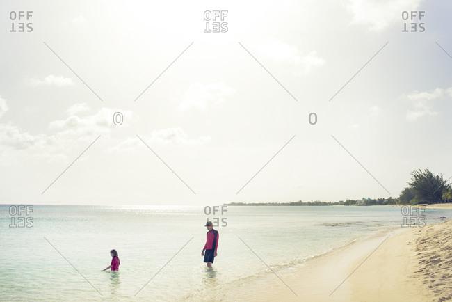 Girl and senior man in ocean