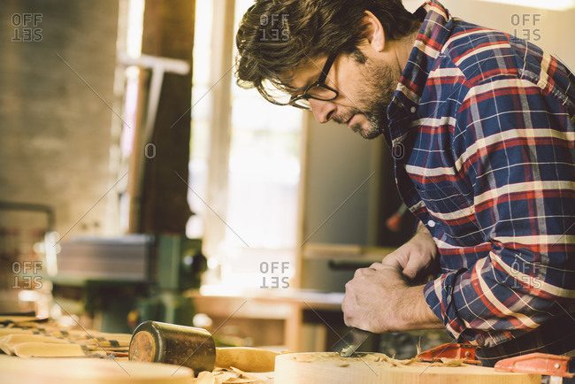 Carpenter shaving piece of wood