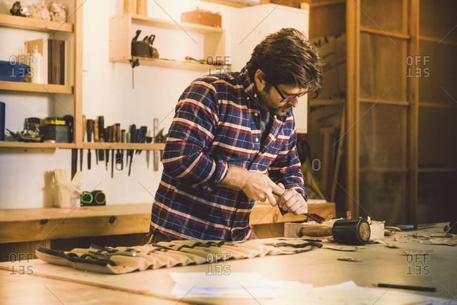 Carpenter shaving a piece of wood