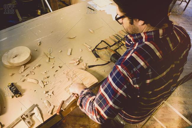 Carpenter shaping wood block