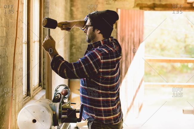 Man preparing wood for shaping