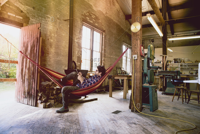 Carpenter in hammock sketching