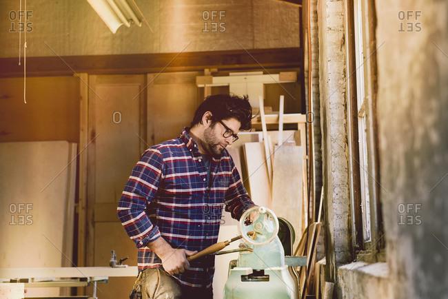 Carpenter at wood molding machine