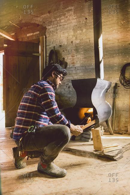 Carpenter building fire in stove