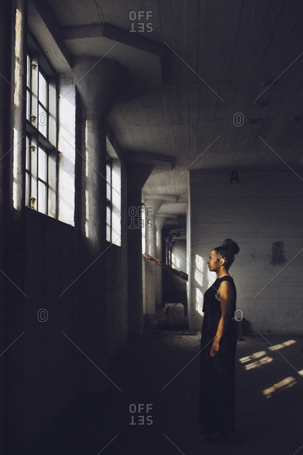 Woman in black dress in industrial building