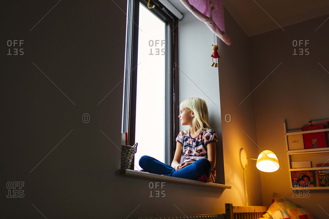 Girl resting in window sill