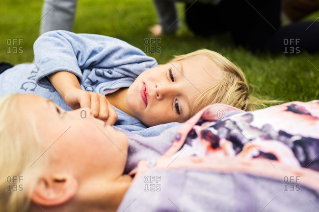 Boy and girl lying in grass