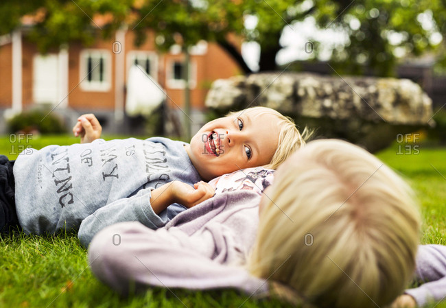 Boy laughing with girl on ground