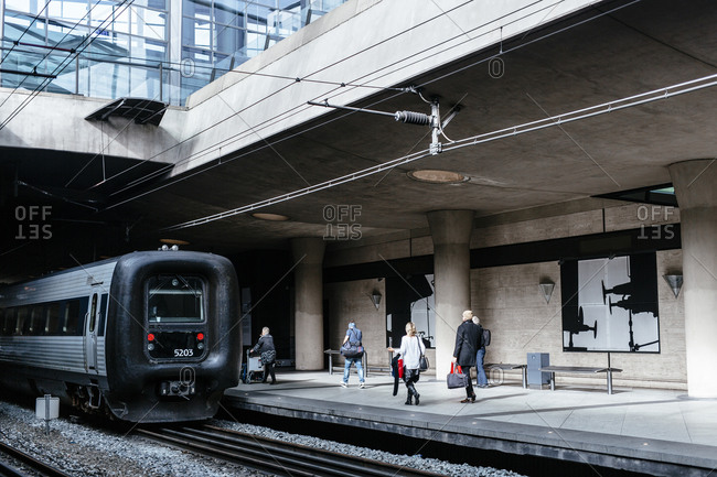 People on a train station platform