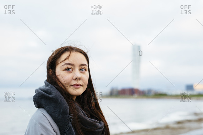 Woman in scarf on a beach