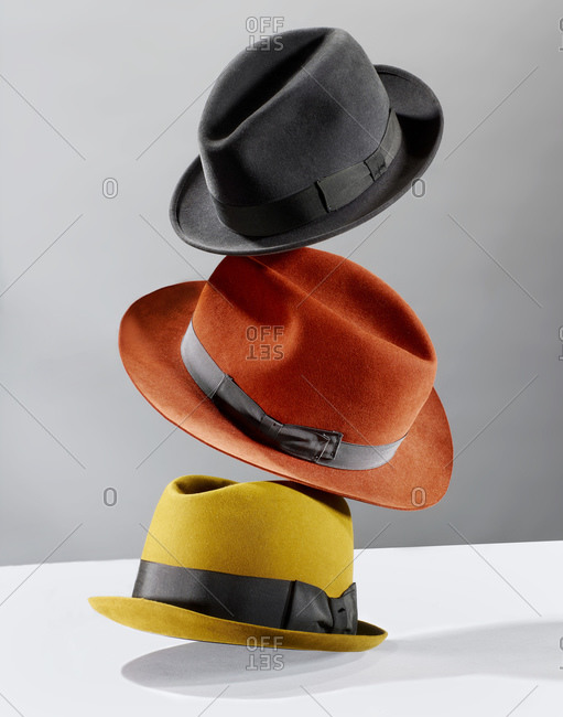 3206860f017f47 Stack of multi-colored hats stock photo - OFFSET