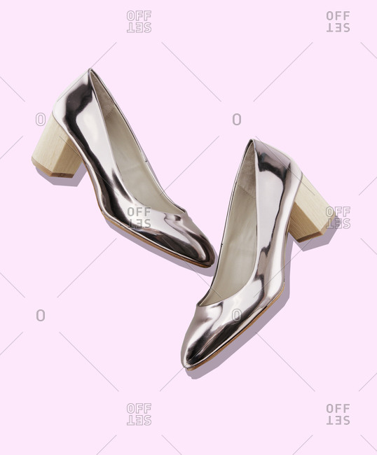 Shiny silver pumps with wooden heels
