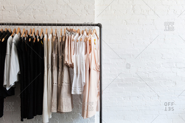Row of clothes hanging on a rack
