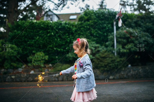 Little girl holding a sparkler