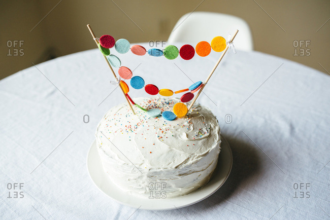 Birthday cake with white frosting and decorations