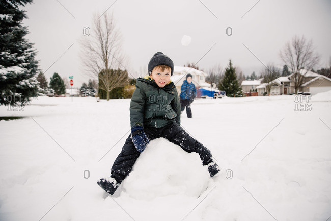 Boys playing in the snow