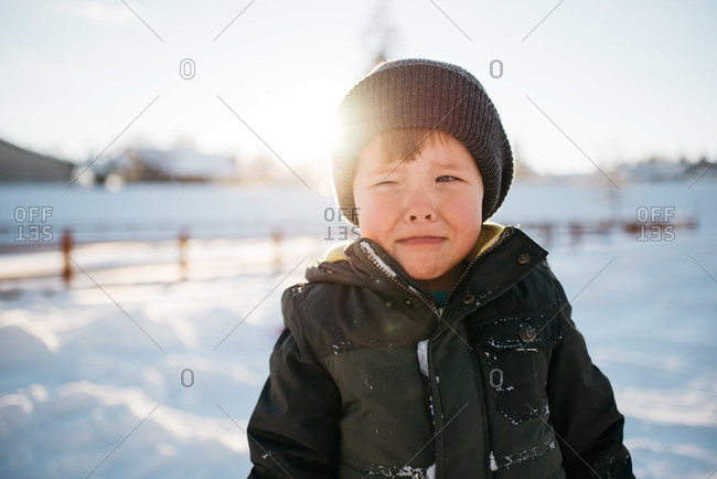 Boy crying while outside in the snow