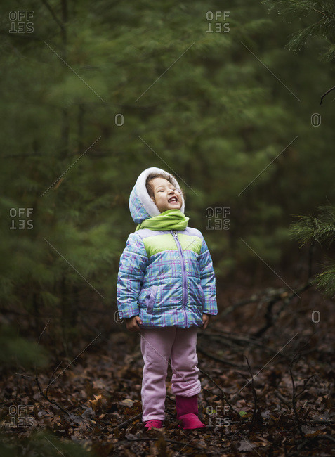 Girl in a forest during damp, chilly weather