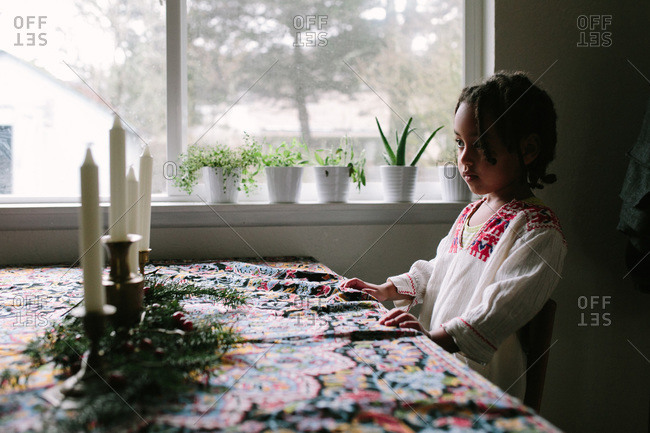 Girl looking at candles on a table