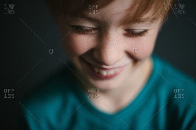 Close up of freckle face boy smiling