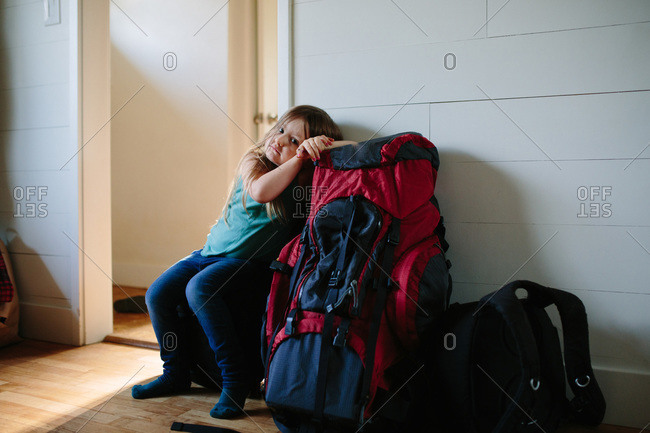 Girl leaning on hiking backpack