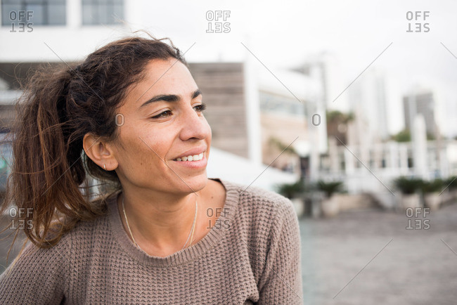 Portrait of a smiling woman looking away