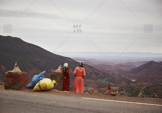 Woman standing on side of road in Morocco
