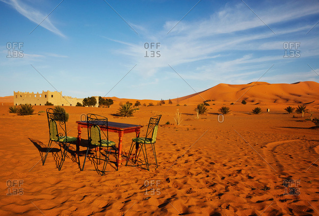 Chairs set around a table in the desert in Morocco