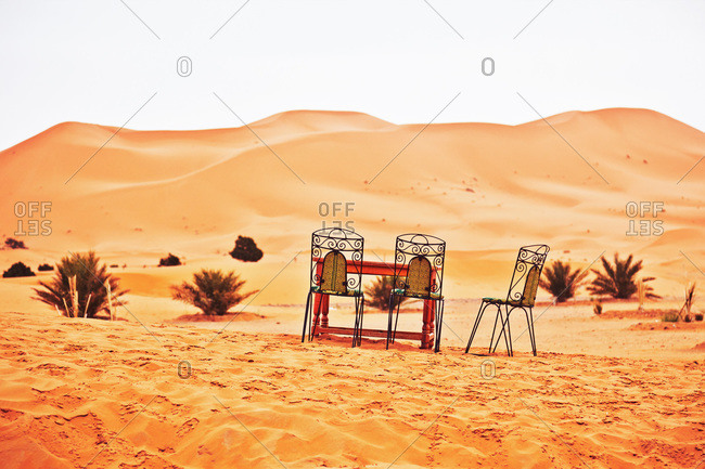 Table and chairs in the desert in Morocco