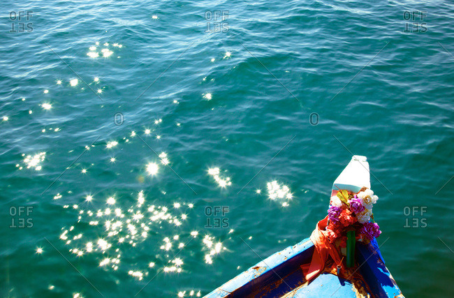 Close up of flowers on the bow of a boat in Thailand