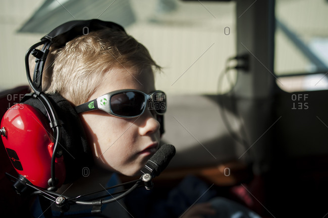 Boy trying on a airplane pilot's headset
