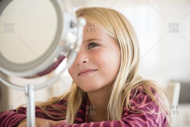 Girl looking at vanity mirror